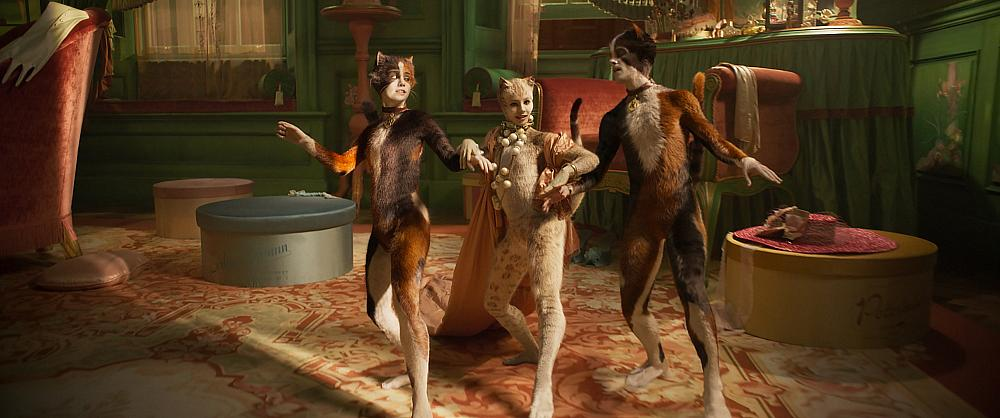 """Rumpleteazer (Naoimh Morgan), Victoria (Francesca Hayward) and Mungojerrie (Danny Collins) in """"Cats,"""" co-written and directed by Tom Hooper. Photo Credit: Universal Pictures"""