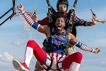 "Harlem Globetrotters Celebrate World Trick Shot Day With First-Ever ""Skydiving Trick Shot"""