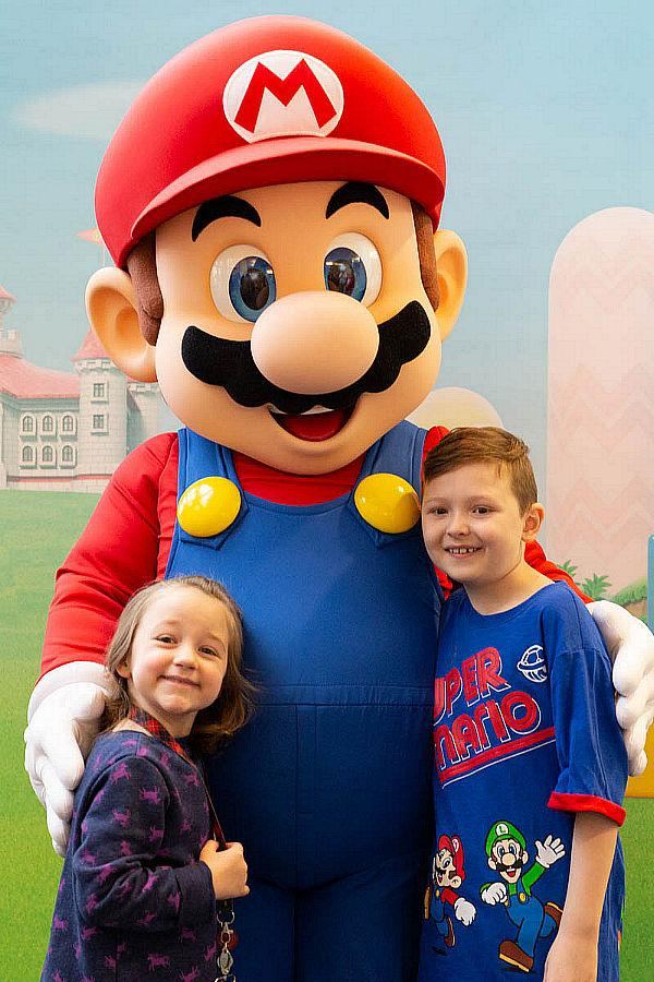 Kids pose with Nintendo's star Mario