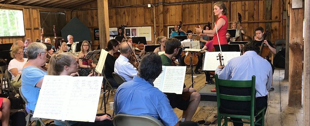 Carolina Hengstenberg, rehearsing an orchestra for a performance in Washington, Maine